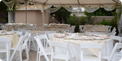 chairs-tables-and-canopies-set-up-at-outdoor-wedding-venue